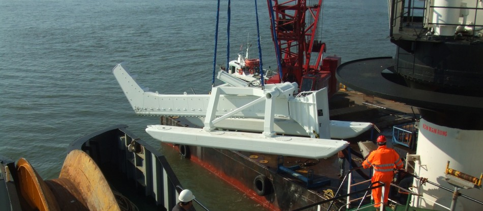 The cable burial hydro-plow is lowered into the Hudson River. (Nov. 2011)