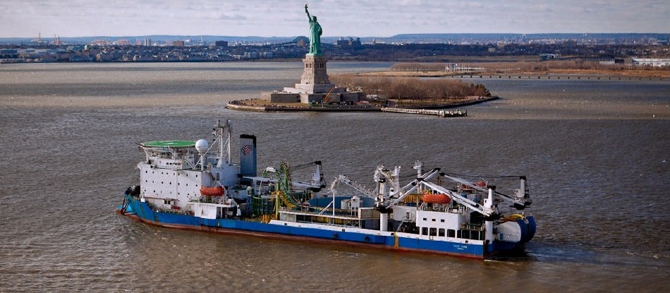 HTP's marine cable Installation is complete and the Giulio Verne exits NY harbor. (January 2012)